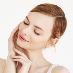 Image of a woman touching her face